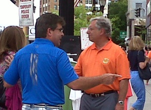 Ron Sall (right, in orange shirt)